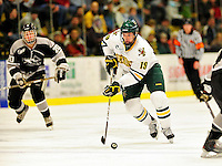 5 February 2011: University of Vermont Catamount forward Matt White, a Freshman from McMurray, PA leads a rush against the Providence College Friars at Gutterson Fieldhouse in Burlington, Vermont. The Catamounts defeated the Friars 7-1 in the second game of their weekend series. Mandatory Credit: Ed Wolfstein Photo