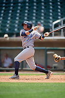 Pensacola Blue Wahoos shortstop Luis Gonzalez (19) follows through on a swing during a game against the Birmingham Barons on May 9, 2018 at Regions Field in Birmingham, Alabama.  Birmingham defeated Pensacola 16-3.  (Mike Janes/Four Seam Images)