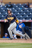 Brett Cumberland (28) of the California Golden Bears follows through on his swing against the Duke Blue Devils at Durham Bulls Athletic Park on February 20, 2016 in Durham, North Carolina.  The Blue Devils defeated the Golden Bears 6-5 in 10 innings.  (Brian Westerholt/Four Seam Images)