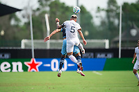 LAKE BUENA VISTA, FL - JULY 23: Francisco Calvo #5 of the Chicago Fire heads the ball during a game between Chicago Fire and Vancouver Whitecaps at Wide World of Sports on July 23, 2020 in Lake Buena Vista, Florida.