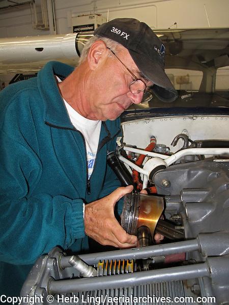 Aeroventure aircraft mechanic Gary Price replaces a piston, Petaluma Municipal Airport, Petaluma, Sonoma County, California
