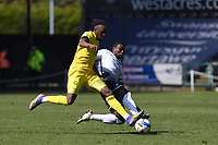 Admiral Muskwe of Wycombe Wanderers is tackled by Marc Guehi of Swansea City during the Sky Bet Championship match Swansea City and Wycombe Wanderers at Liberty Stadium in Swansea, Wales. Sporting stadiums around the UK remain under strict restrictions due to the Coronavirus Pandemic as Government social distancing laws prohibit fans inside venues resulting in games being played behind closed doors.<br /> Saturday 17 April 2021