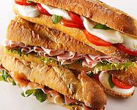 Bread baguettes filled with mozerella & tomatoes, ham & salad, Prcutto ham & rocket.