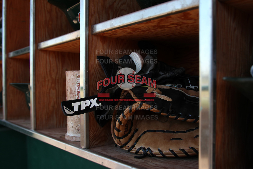 Fort Wayne TinCaps glove and batting gloves in the helmet rack during a game against the Quad Cities River Bandits at Parview Field on July 25, 2011 in Fort Wayne, Indiana.  Quad Cities defeated Fort Wayne 11-10.  (Mike Janes/Four Seam Images)