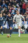 Cristiano Ronaldo (r) of Real Madrid vies for the ball with Luis Munoz of Malaga CF during their La Liga 2016-17 match between Real Madrid and Malaga CF at the Estadio Santiago Bernabéu on 21 January 2017 in Madrid, Spain. Photo by Diego Gonzalez Souto / Power Sport Images