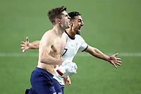 6th June 2021. Denver, Colorado, USA;  United States forward Christian Pulisic celebrates with United States midfielder Sebastian Lletget after scoring a goal from a penalty kick in extra time action during the CONCACAF Nations League finals between Mexico and the United States  at Empower Field at Mile High in Denver, CO.