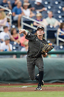 Vanderbilt Commodores third baseman Will Toffey (10) makes a throw to first base during the NCAA College baseball World Series against the Cal State Fullerton Titans on June 14, 2015 at TD Ameritrade Park in Omaha, Nebraska. The Titans were leading 3-0 in the bottom of the sixth inning when the game was suspended by rain. (Andrew Woolley/Four Seam Images)
