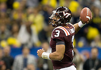 Logan Thomas of Virginia Tech throws the ball during Sugar Bowl game at Mercedes-Benz SuperDome in New Orleans, Louisiana on January 3rd, 2012.  Michigan defeated Virginia Tech, 23-20 in first overtime.