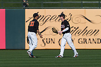 Oregon State Beavers center fielder Preston Jones (33) is congratulated by Joe Casey (6) after making a diving catch during a game against the Gonzaga Bulldogs on February 16, 2019 at Surprise Stadium in Surprise, Arizona. Oregon State defeated Gonzaga 9-3. (Zachary Lucy/Four Seam Images)