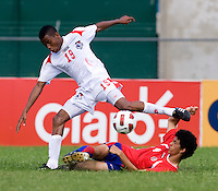 David Acuna (4) of Costa Rica tries to tackle the ball away from Alfredo Stephens (19) of Panama during the quarterfinals of the CONCACAF Men's Under 17 Championship at Catherine Hall Stadium in Montego Bay, Jamaica. Panama defeated Costa Rica, 1-0.