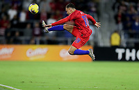 ORLANDO, FL - NOVEMBER 15: Sergino Dest #18 of the United States fly's through the air for a ball during a game between Canada and USMNT at Exploria Stadium on November 15, 2019 in Orlando, Florida.