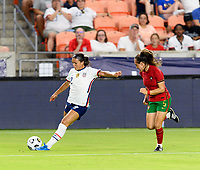 HOUSTON, TX - JUNE 10: Sophia Smith #2 of the United States takes a shot at the Portugal goal with Joana Marchao #5 of Portugal closing in during a game between Portugal and USWNT at BBVA Stadium on June 10, 2021 in Houston, Texas.