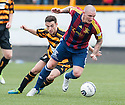 Livy's Martin Scott gets away from Alloa's Kevin Cawley.