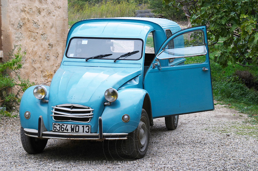 A blue old Citroen 2CV 2 CV converted into a transport van. Moulin Mas des Barres olive mill, Maussanes les Alpilles, Bouches du Rhone, Provence, France, Europe