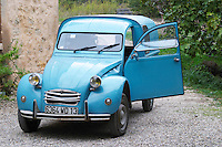 A blue old Citroen 2CV 2 CV converted into a transport van. Moulin Mas des Barres olive mill, Maussanes les Alpilles, Bouches du Rhone, Provence, France, Europe