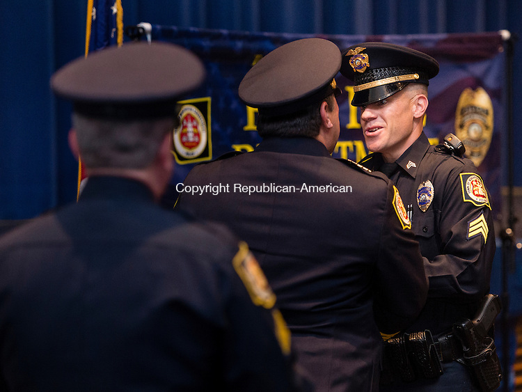 """WINSTED, CT- 18 May 2016-051816EC11-  Jason Hermenau is congratulated during a presentation for """"Officer of the Year."""" The Winchester Police Department held its first awards ceremony Wednesday night at The Gilbert School. Erin Covey Republican-American"""