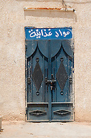 "Bir al-Ghanem, south of Tripoli, Libya - Typical Metal Door.  Arabic Inscription above says ""Foodstuffs."""