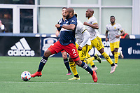 FOXBOROUGH, MA - MAY 16: Andrew Farrell #2 of New England Revolution passes the ball during a game between Columbus SC and New England Revolution at Gillette Stadium on May 16, 2021 in Foxborough, Massachusetts.