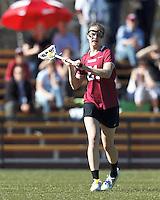 Harvard University midfielder Audrey Todd (21) passes the ball.