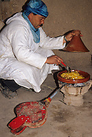 Near Skoura, Morocco - Aziz, Caretaker of the Ameridhil Kasbah, Prepares Lunch over a Charcoal Fire.