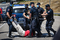 """MADRID, SPAIN – JUNE 21: People protest in front of the research center of the oil company Repsol on June 21 in Madrid, Spain. Activists from XR (Extinction Rebellion) and other environmental associations such as """"amigos por la tierra"""" and greenpeace have blocked the entrance to the Repsol research center in Móstoles, calling for the cessation of their fossil activities as a measure to climate change. (Photo by Joan Amengual/VIEWpress)"""