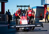 Oct 14, 2019; Concord, NC, USA; Crew members for NHRA top fuel driver Doug Kalitta during the Carolina Nationals at zMax Dragway. Mandatory Credit: Mark J. Rebilas-USA TODAY Sports