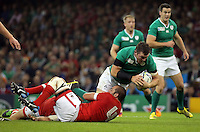 Pictured: Peter O'Mahony of Ireland (with ball) is brought down by Jamie Cudmore of Canada Saturday 19 September 2015<br /> Re: Rugby World Cup 2015, Ireland v Canada at the Millennium, Stadium, Wales, UK