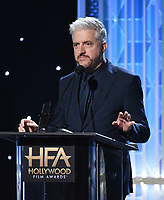 """BEVERLY HILLS - NOVEMBER 3: Anthony McCarten accepts the Hollywood Screenwriter Award for """"The Two Popes"""" onstage at the 2019 Hollywood Film Awards at the Beverly Hilton on November 3, 2019 in Beverly Hills, California. (Photo by Frank Micelotta/PictureGroup)"""