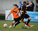 United's Ryan Dow is caught late by Alloa's Mark Docherty.
