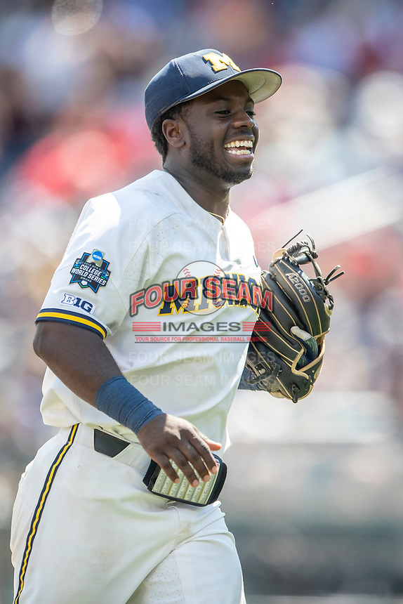 Michigan Wolverines second baseman Ako Thomas (4) smiles during Game 11 of the NCAA College World Series against the Texas Tech Red Raiders on June 21, 2019 at TD Ameritrade Park in Omaha, Nebraska. Michigan defeated Texas Tech 15-3 and is headed to the CWS Finals. (Andrew Woolley/Four Seam Images)