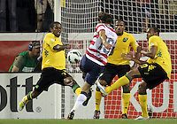COLUMBUS, OHIO - SEPTEMBER 11, 2012:  Graham Zusi (19) of the USA MNT shoots past Jason Morrison (7), Ryan Johnson (9) and Rodolph Austin (17) of  Jamaica during a CONCACAF 2014 World Cup qualifying  match at Crew Stadium, in Columbus, Ohio on September 11. USA won 1-0.