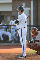 Tripp Martin #24 of the Coastal Carolina University Chanticleers at bat against the Boston College Eagles at Watson Stadium at Vrooman Field in Conway, South Carolina on February 18, 2011. Photo by Robert Gurganus/Four Seam Images