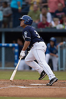 Asheville Tourists catcher Wilfredo Rodriguez #3 swings at a pitch during a game against the Savannah Sand Gnats at McCormick Field July 17, 2014 in Asheville, North Carolina. The Tourists defeated the Sand Gnats 8-7. (Tony Farlow/Four Seam Images)