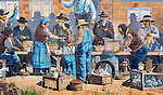 Toppenish, the City of Murals, in Washington State's Yakima Valley, with 300 days of sunshine per year sports some of the finest vineyards in the state.  Rattlesnake Hills AVA shares hillsides and valley with traditional orchard crops.  Mural:  Partial image of The Old Saturday Market by Robert Thomas.