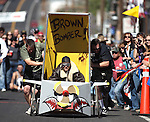 The Brown Bomber runs in an early heat of Outhouse Races in Virginia City, Nev, on Saturday, Oct. 1, 2011. Competition continues Sunday at noon..Photo by Cathleen Allison