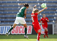 The sweat flies a Chicago Red Star forward Crisitane (11) sends a header on goal over Washington Freedom defender Sonia Bompastor (8).  The Washington Freedom defeated the Chicago Red Stars 3-2 at Toyota Park in Bridgeview, IL on July 26, 2009.