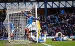 Harry Forrester, Andy Halliday and Rob Kiernan all throw themselves at the goal