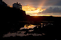 """22/10/19<br /> <br /> The sun sets behind the Old Coastguards House in Appledore, on the North Devon coast, casting stunning Crepuscular rays into the sky above the Taw and Torridge Estuary. Also known as """"God rays"""" these sunbeams originate when the sun is below the horizon, during twilight hours. Crepuscular rays usually appear orange because the path through the atmosphere at sunrise and sunset passes through up to 40 times as much air as rays from a high midday sun.<br /> <br /> All Rights Reserved: F Stop Press Ltd.  <br /> +44 (0)7765 242650 www.fstoppress.com"""
