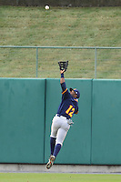 Montgomery Biscuits John Shelby #12 jumps for a ball during a game against  the Tennessee Smokies at Smokies Park in Kodak,  Tennessee;  April 13, 2011.  Tennessee defeated Montgomery 12-2.  Photo By Tony Farlow/Four Seam Images