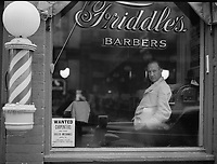 Poster in the window of a business in Harrisonburg, Virginia for the State Employment Service aiding in the tapping of the skilled labor resources of the Shenandoah Valley, 1941.<br /> <br /> Photo by John Vachon.