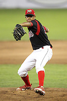 Batavia Muckdogs relief pitcher Ricky Martinez #33 delivers a pitch during a game against the Tri-City ValleyCats at Dwyer Stadium on July 15, 2011 in Batavia, New York.  Batavia defeated Tri-City 4-3.  (Mike Janes/Four Seam Images)