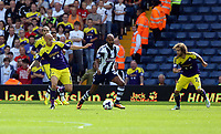 Pictured: Nicolas Anelka of West Brom (C) against Jonjo Shelvey (L) and Jose Canas of Swansea (R). Sunday 01 September 2013<br /> Re: Barclay's Premier League, West Bromwich Albion v Swansea City FC at The Hawthorns, Birmingham, UK.