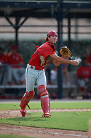 Philadelphia Phillies catcher Micah Yonamine (18) throws to first base during an Instructional League game against the Toronto Blue Jays on September 27, 2019 at Englebert Complex in Dunedin, Florida.  (Mike Janes/Four Seam Images)