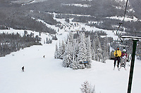 People ride the Payload triple chair at Showdown Ski Area on King's Hill in the Little Belt Mountains near Neihart, Montana, USA.