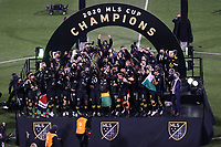 COLUMBUS, OH - DECEMBER 12: Columbus Crew captain Jonathan Mensah #4 lifts the Philip F. Anschutz MLS Cup Trophy with his teammates and coaches after a game between Seattle Sounders FC and Columbus Crew at MAPFRE Stadium on December 12, 2020 in Columbus, Ohio.