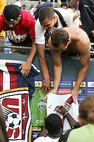 Freddy Adu signs autographs for fans after the game. USA defeated Grenada 4-0 during the First Round of the 2009 CONCACAF Gold Cup at Qwest Field in Seattle, Washington on July 4, 2009.