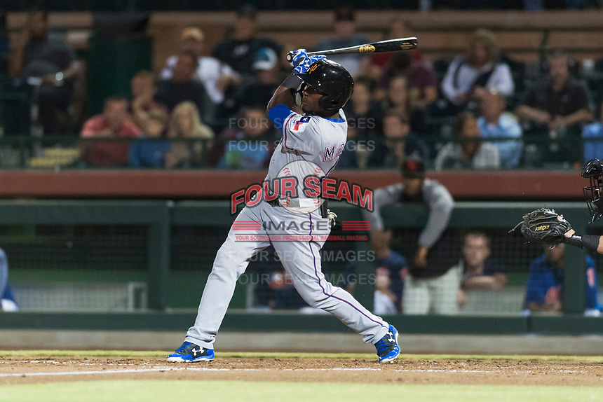 Surprise Saguaros left fielder Julio Pablo Martinez (40), of the Texas Rangers organization, follows through on his swing during an Arizona Fall League game against the Scottsdale Scorpions at Scottsdale Stadium on October 15, 2018 in Scottsdale, Arizona. Surprise defeated Scottsdale 2-0. (Zachary Lucy/Four Seam Images)