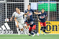 FOXOBOROUGH, MA - AUGUST 21: Emmanuel Boateng #11 of New England Revolution prepares to chase down a rebound near the FC Cincinnati goal during a game between FC Cincinnati and New England Revolution at Gillette Stadium on August 21, 2021 in Foxoborough, Massachusetts.