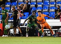 LAKE BUENA VISTA, FL - JULY 18: Yimmi Chará #23 of the Portland Timbers moves away from Memo Rodríguez #8 of the Houston Dynamo during a game between Houston Dynamo and Portland Timbers at ESPN Wide World of Sports on July 18, 2020 in Lake Buena Vista, Florida.