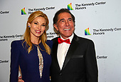 Steve Wynn and his wife, Andrea, arrive for the formal Artist's Dinner honoring the recipients of the 42nd Annual Kennedy Center Honors at the United States Department of State in Washington, D.C. on Saturday, December 7, 2019. The 2019 honorees are: Earth, Wind & Fire, Sally Field, Linda Ronstadt, Sesame Street, and Michael Tilson Thomas.<br /> Credit: Ron Sachs / Pool via CNP
